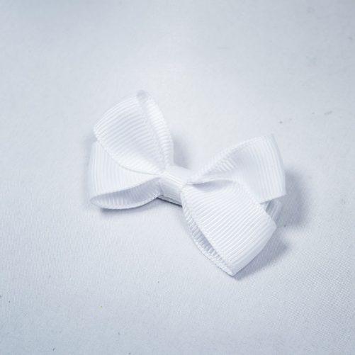 Hårspänne rosett barn vit. Fina hårspännen barn med rosett. Beställ hår accessoarer barn på LillaFilur.se