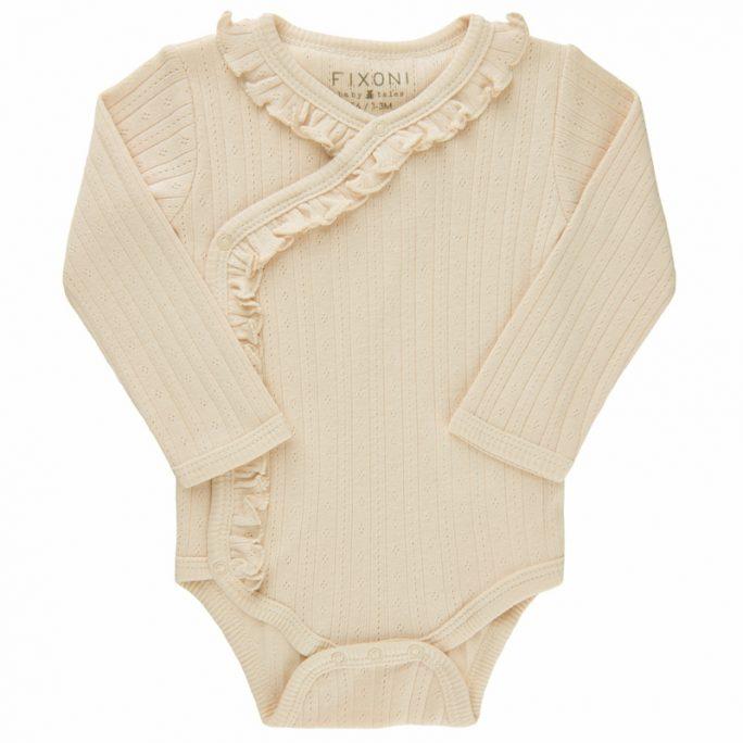 Body storlek 44 cl till flicka. Ljusrosa body med omlott stängning. Ekologiska babykläder. LillaFilur.se
